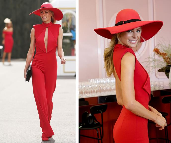 The 32-year-old stunned in a cherry red jumpsuit by Misha Collection.