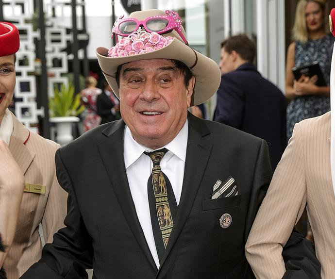 Molly Meldrum was ready for a good time as he arrived in the hands of Emirates stewardesses.