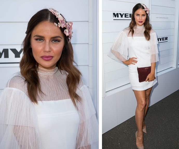 Jodi Anasta kept things simple in a tiered white mini, paired with floral accessories.