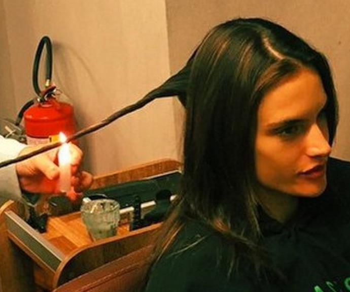 Again, do NOT try this one at home... Victoria's Secret model Alessandra Ambrosio is ditching scissors, and instead going about her haircuts with an open flame. The bizarre technique is a Brazilian treatment called Velaterapia, where split ends are literally burnt off.