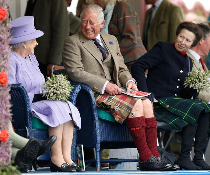 Charles, pictured at this year's Highland Games, making his mother and sister giggle.