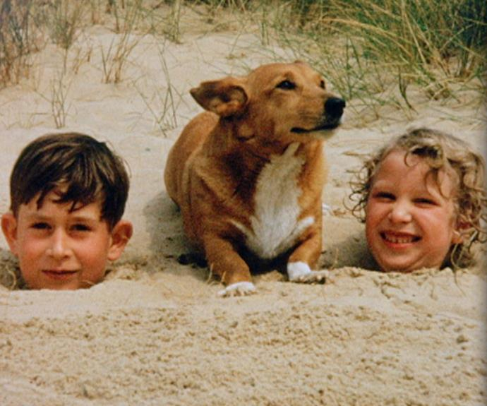 A rare glimpse from his childhood, released for the The Prince of Wales Jubilee Tribute documentary, shows Charles and his sister Anne play on the beach with the family corgi.