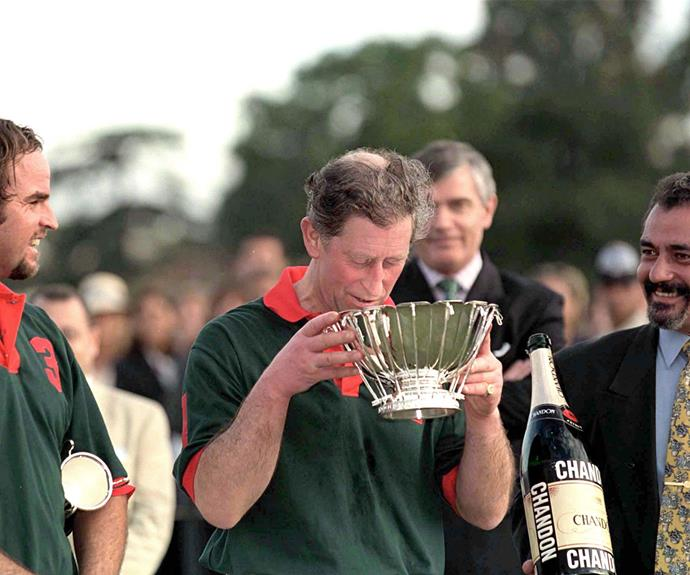 After winning a polo match, the Prince celebrates by drinking champagne from the winning cup.