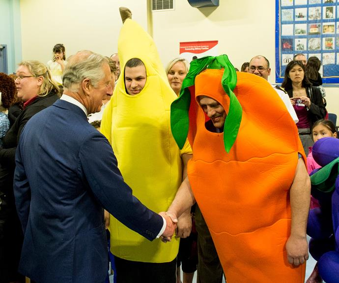 Orange you happy to meet the Prince?! Charles greets what appears to be two runaway members of the fruit bowl on a tour to Canada.