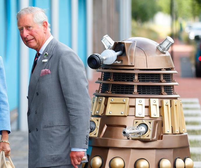Charles appears unimpressed by a robot follower as he visits the set of *Doctor Who*.