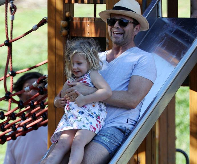 Francesca goes for a slide with daddy.