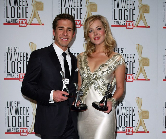 Jess and her baby-faced *Packed to the Rafters* co-star Hugh Sheridan strike a pose with their gongs.