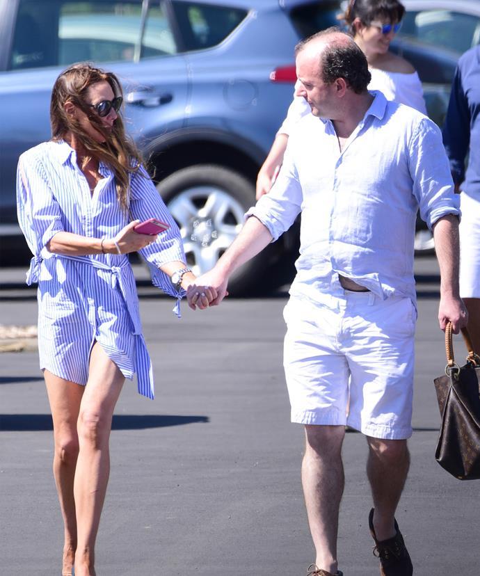 Walking hand in hand with Sanchia, Paul looks happy again.