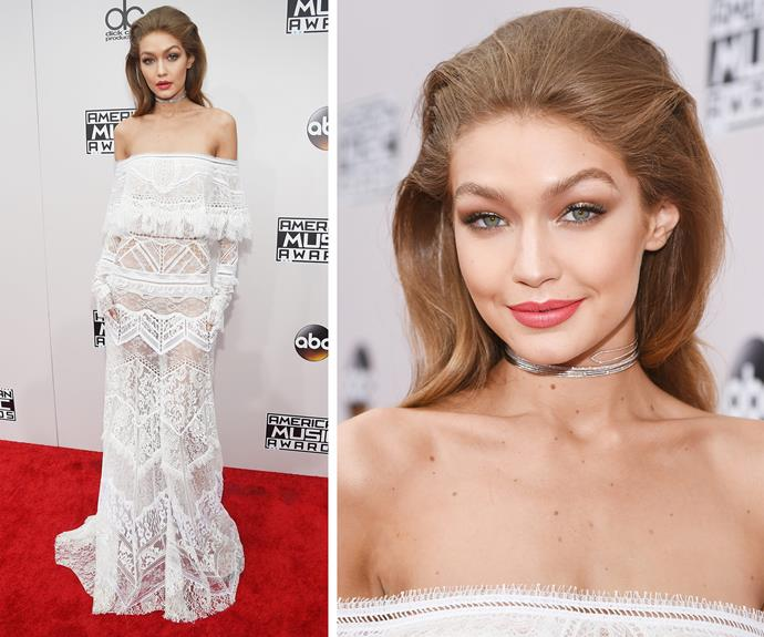 Gigi Hadid was breathtaking as she wore her first number of the night, a stunning off-the-shoulder lace gown.