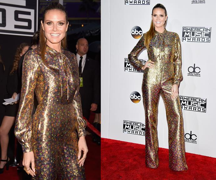 Straight from Studio 54, Heidi Klum rocked an eye-catching gold jumpsuit.