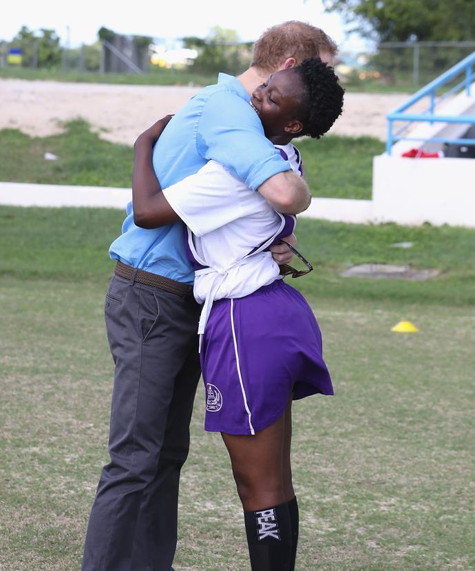 Harmony Edwards shares a hug with Harry.