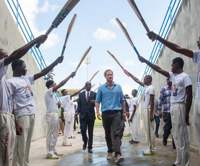 A guard of honour erected by cricket bats.