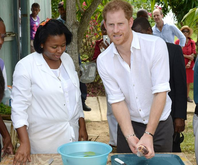 The beloved royal put his kitchen skills to test at the Sir McChesney High School in Barbuda.