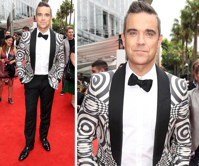 "Robbie Williams confessed Kylie Minogue is ""the crush that never stops!"" While adding, ""we've done a new song together called *Disco Symphony.*"" The singer also admitted he was loving the low-key vibe of the red carpet. ""This is the most relaxed red carpet on the planet."""