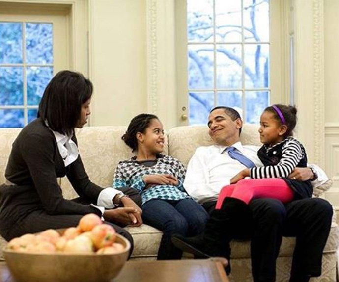 "To mark Thanksgiving, Michelle Obama posted this flashback pic of her daughters cuddling up to their dad. ""Today and every day we have a lot to be thankful for. From our family to yours - Happy Thanksgiving,"" the First Lady mused."