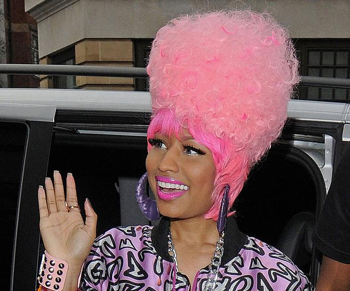 Is it just us, or is Nicki Minaj actually pulling off this highlighter-pink poodle up-do?!