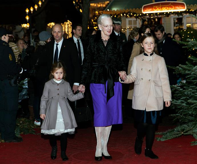 The lively 76-year-old is accompanied by her little granddaughters.
