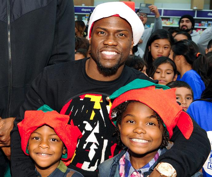 """Nobody does Christmas quite like Kevin Hart! The comedian and his two mini-mes, daughter Heaven and son Hendrix, spread joy at the CP3 Foundation's 100 Children for Holiday Shopping Spree event at every kid's favourite place, Toys """"R"""" Us."""