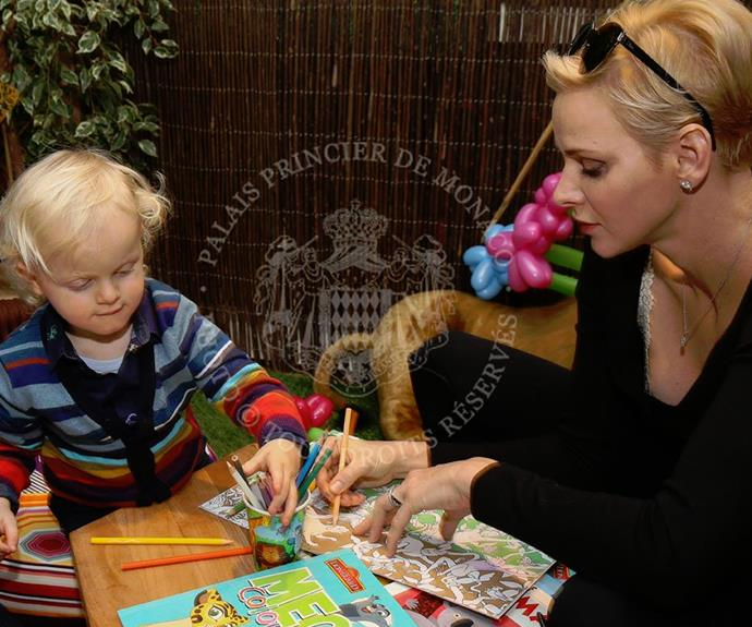 The adorable tot invited his nursery school classmates. Here, the birthday boy enjoys some good old fashioned colouring with his mum.