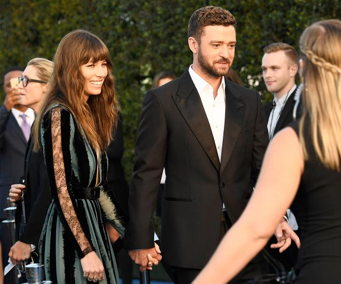 Jessica Biel holds hands with her hubby, Justin Timberlake.