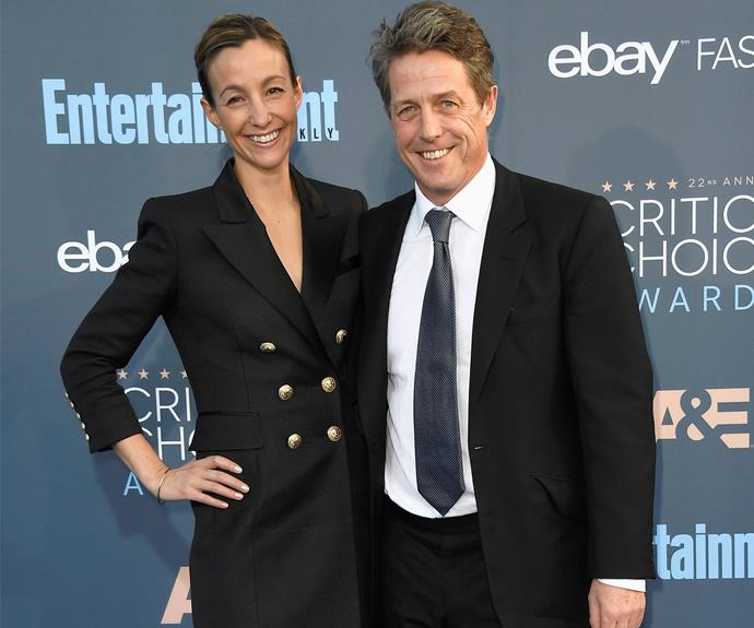 Hugh Grant beamed as he walked the red carpet with Anna Eberstein.