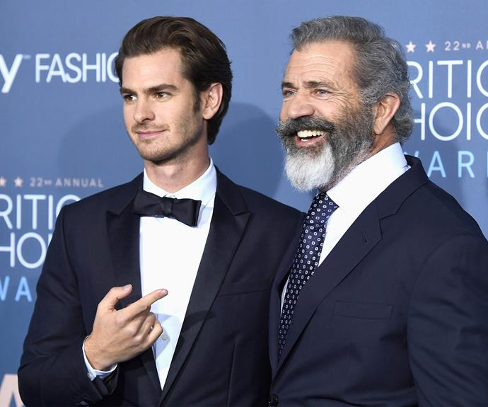 Andrew Garfield cuddles up to Mel Gibson.
