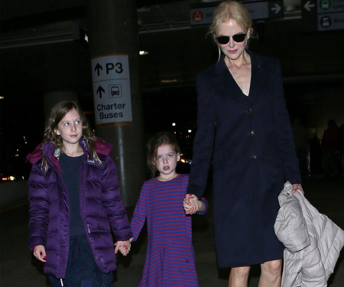 Nic and her daughters were pictured leaving LAX bound for Sydney on December 14.