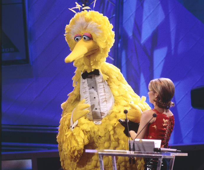 **Big Bird takes to the stage** <br><br> *Sesame Street* resident Big Bird paid a visit to the Logies in 1995. The beloved yellow bird was joined on-stage by *E Street's* Alyssa-Jane Cook and a group of talented kids for a tribute to children's television.