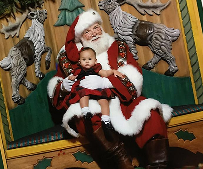 """It's Chrissy Teigen and John Legend's daughter Luna's first Christmas she's already a pro at this Santa photo business. """"When your husband is in Paris but you gotta get your Santa on,"""" proud mum Chrissy tweeted."""