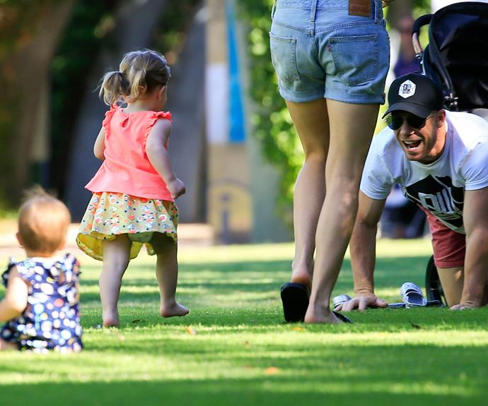 Ivy goes for a home run straight to her daddy.