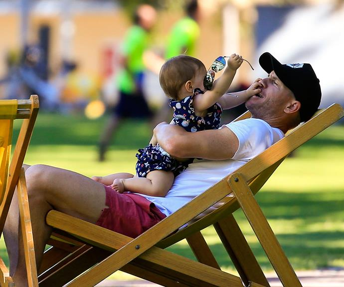 Kicking back on a deckchair and soaking up the Brisbane sun, David thought he'd sneaked in some R and R until Indi Rae stole Daddy's sunnies!