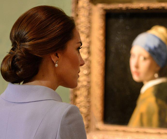 **Flyin' Solo:** Kate got to tap into her love of art as she embarked on her very first solo international royal tour of The Netherlands. Here the mother-of-three is observing one of the gems of the art world, *The Girl With The Pearl Earring*.