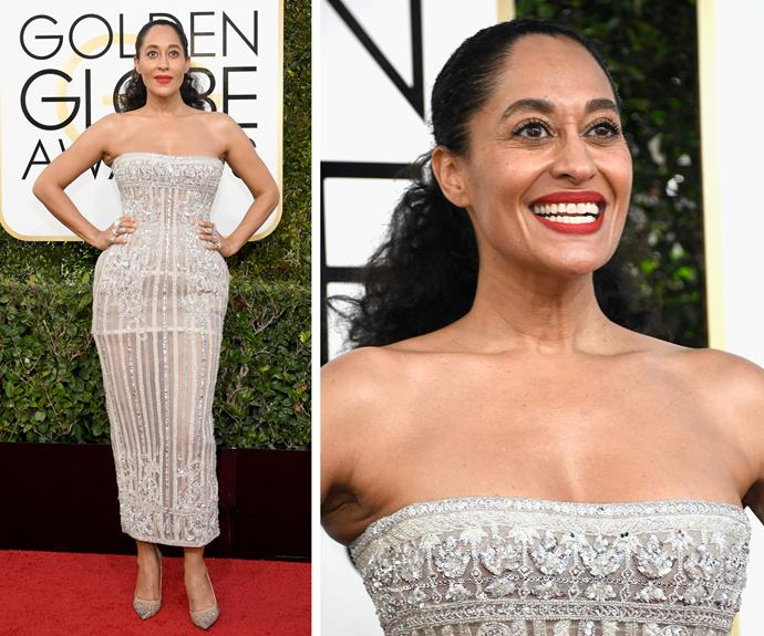 Tracee Ellis Ross teamed her her sparkling strapless dress with a bright red lip.