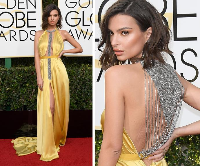 Emily Ratajkowski works a sultry vibe in a plunging yellow gown.