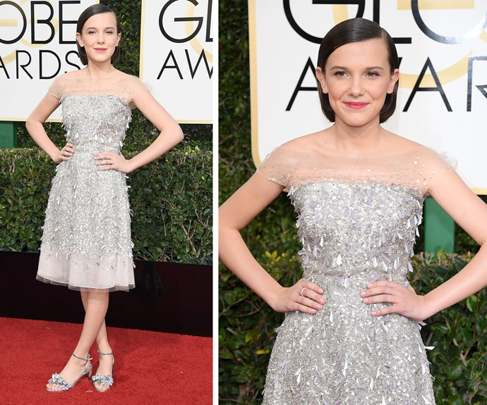 *Stranger Things* actress Millie Bobby Brown shimmers in a silver knee-length dress.