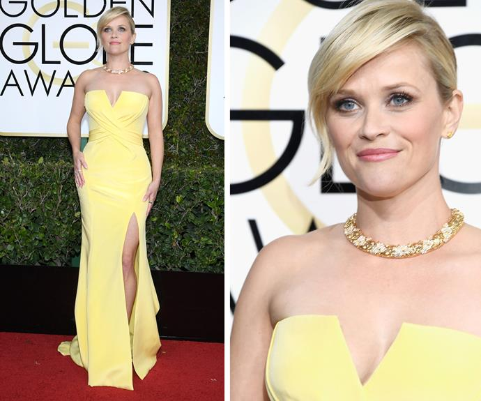 Reese Witherspoon worked a toned-down look in a strapless yellow gown.