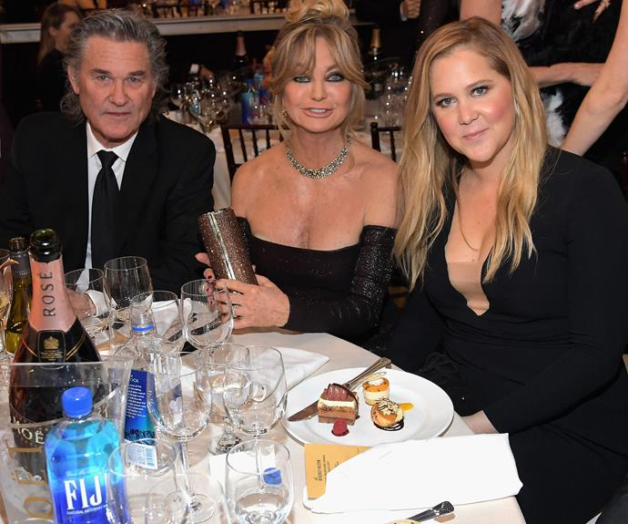 Amy catches up with her on-screen mother, Goldie Hawn, and Kurt Russell.