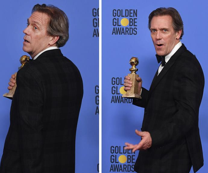 Hugh Laurie seems pretty chuffed with his new accessory.