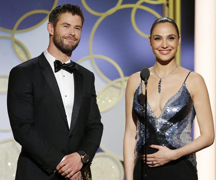Chris Hemsworth and pregnant *Wonder Woman* actress Gal Gadot present an award.