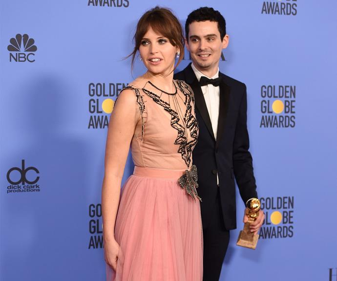 Felicity Jones congratulates her *Manchester by the Sea* co-star Casey Affleck on the Best Actor in a Motion Picture win.