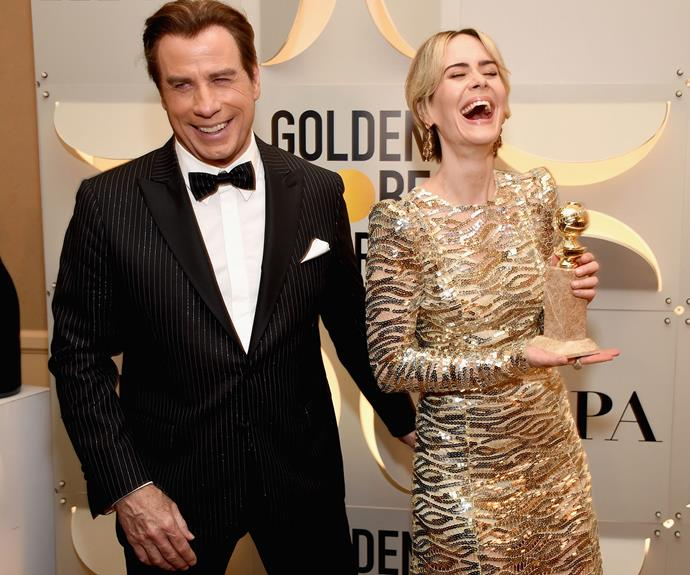John Travolta and Sarah Paulson share a laugh.