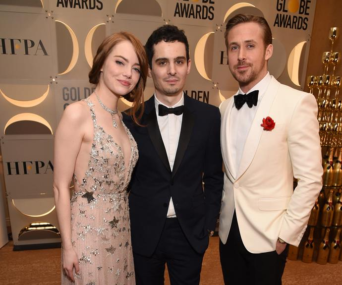 "*La La Land* trio Emma Stone, director Damien Chazelle and actor Ryan Gosling cuddle up at the Moet & Chandon party. During the night, Ryan admitted to one reporter he'd had ""too much champagne"" to answer his philosophical question about love. While his co-star Emma celebrated her success by dancing to Beyonce's *Crazy In Love*.  **Watch the hilarious moment in the next slide**"
