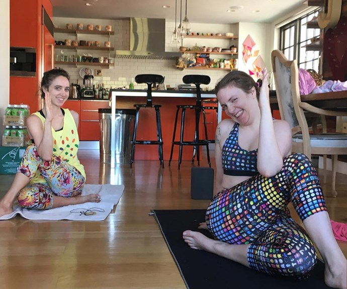 Lena Dunham opts for living room yoga with the help of a pal, proving that you don't need a gym membership or even a yoga mat if you have a towel!