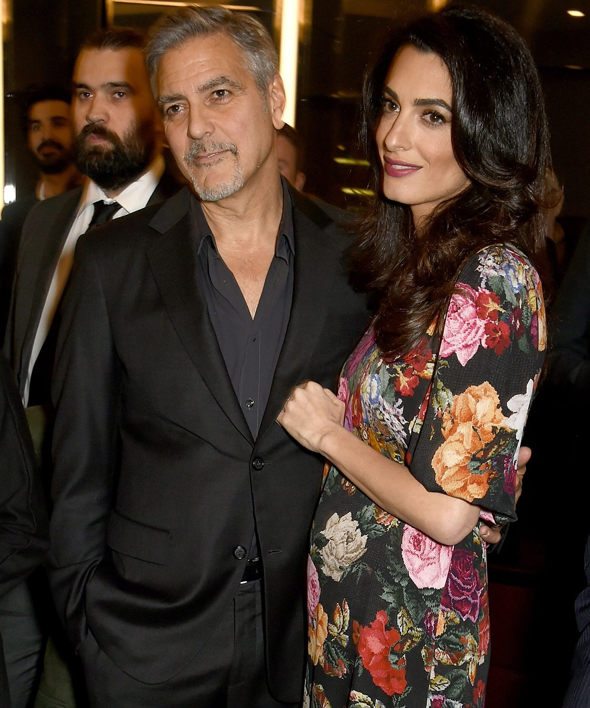 During a recent outing, Amal's loose-fitting dress looked to skim over a bump.