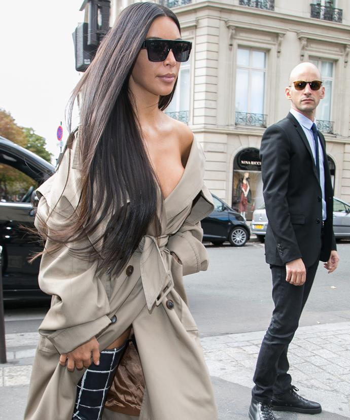 Kim, pictured in Paris, is snapped with her driver Michael Madar, prior to the robbery.