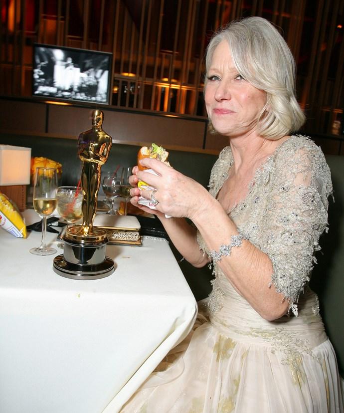 Helen Mirren chomps away on a post Oscar burger.