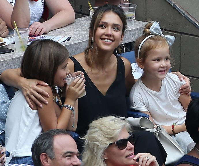 Jessica pictured at the tennis with daughters Honor, eight, and Haven, five.