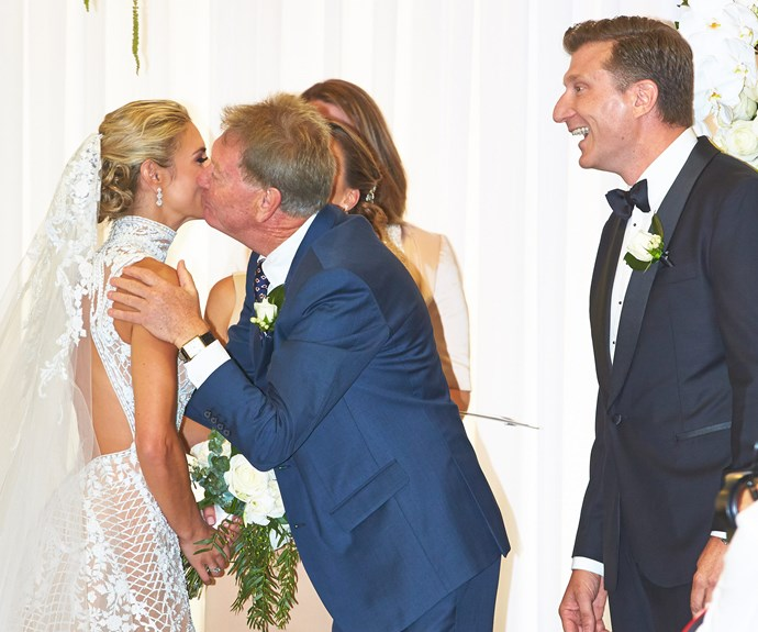 Simon watches on as Loz's dad David gives her a parting kiss.