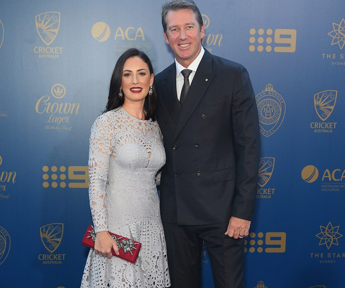 Glenn McGrath's smile couldn't have been brighter as he posed arm-in-arm with wife Sara, whose icy-blue frock was complemented by pops of deep red.