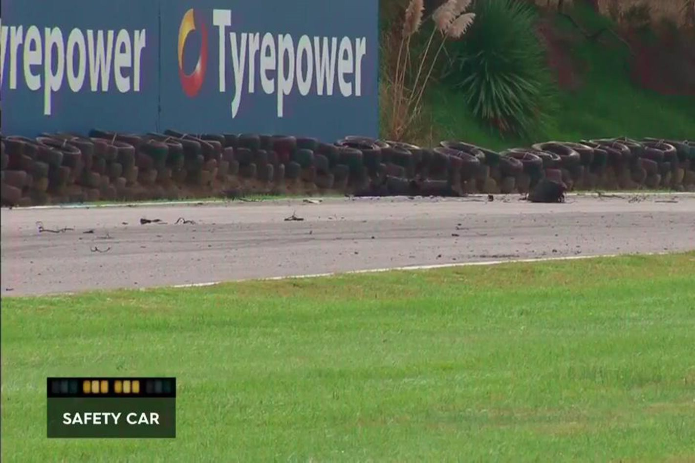 Tyre debris litters the track at the Phillip Island Supercars round